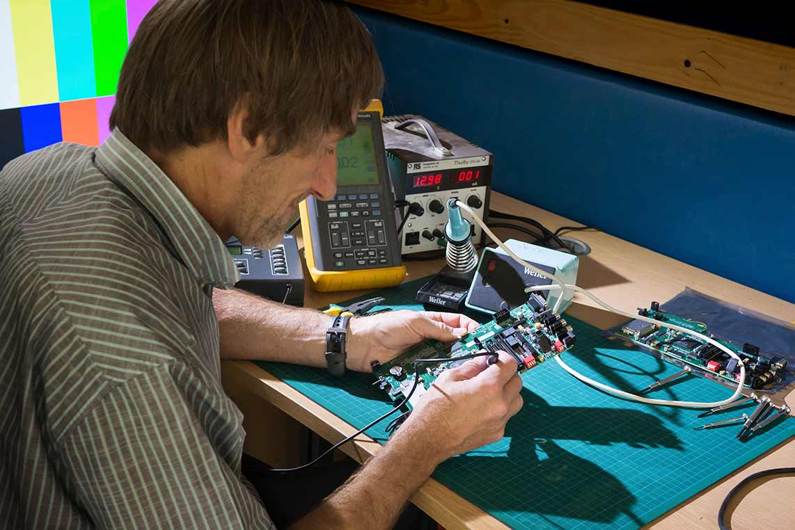 One of Sarner International's Audio Visual Engineers soldering a circuit board
